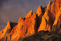 The craggy peaks of Titcomb Basin glow at sunset in the Wind River Range of Wyoming.