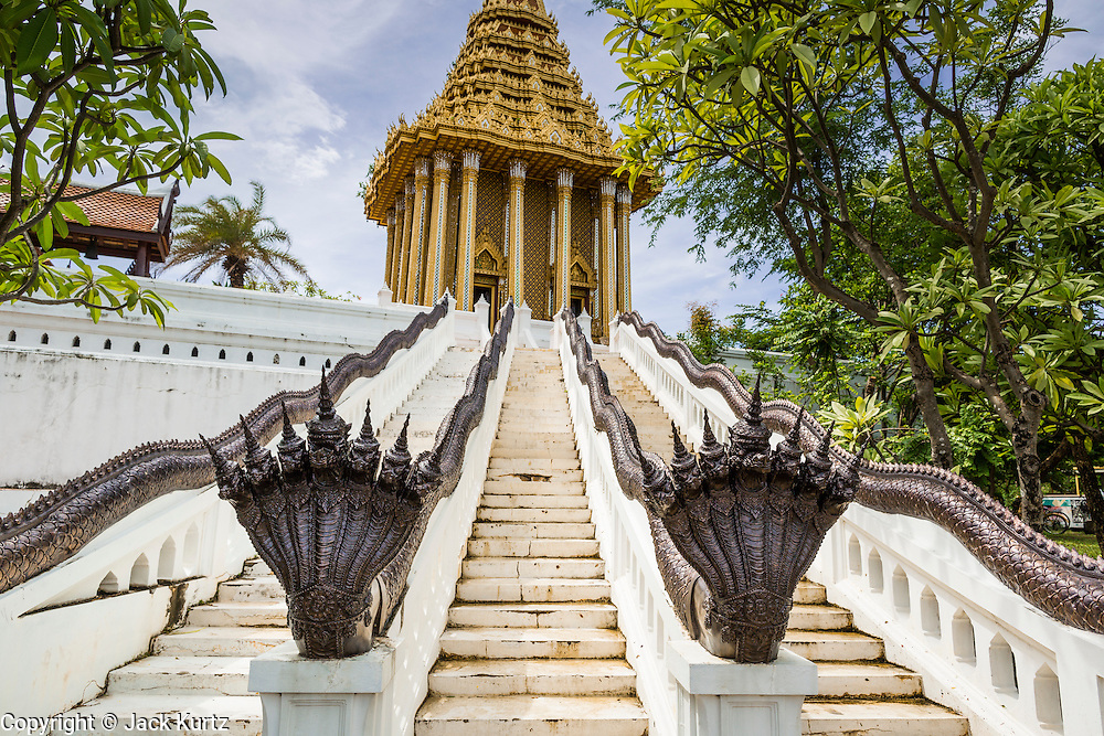"""16 JULY 2014 - SAMUT PRAKAN, SAMUT PRAKAN, THAILAND: A replica of the """"mondop"""" a Buddhist chapel that houses a footprint of the Buddha in Saraburi, at Ancient Siam. Ancient Siam is a historic park about 200 acres (81 hectares) in size in the city of Samut Prakan, province of Samut Prakan, about 90 minutes from Bangkok. It features historic recreations of important Thai landmarks and is shaped roughly like the country of Thailand.      PHOTO BY JACK KURTZ"""