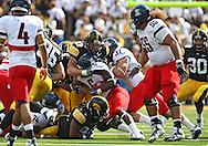 September 19, 2009: Iowa linebacker Pat Angerer (43) brings down Arizona running back Nic Grigsby (5) during the Iowa Hawkeyes' 27-17 win over the Arizona Wildcats at Kinnick Stadium in Iowa City, Iowa on September 19, 2009.