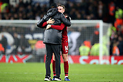 Liverpool Manager Jurgen Klopp gives his captain Liverpool midfielder Jordan Henderson (14) a hug at the end of the Champions League Group C match between Liverpool and Napoli at Anfield, Liverpool, England on 11 December 2018.