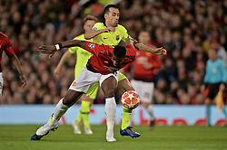 MANCHESTER, ENGLAND - Thursday, April 11, 2019: Barcelona's Sergio Busquets challenges Manchester United's Paul Pogba during the UEFA Champions League Quarter-Final 1st Leg match between Manchester United FC and FC Barcelona at Old Trafford. Barcelona won 1-0. (Pic by David Rawcliffe/Propaganda)