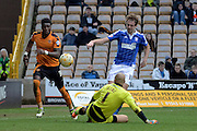 Ipswich Town striker Brett Pitman chips Wolverhampton Wanderers goalkeeper Carl Ikeme during the Sky Bet Championship match between Wolverhampton Wanderers and Ipswich Town at Molineux, Wolverhampton, England on 2 April 2016. Photo by Alan Franklin.