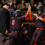 16 February 2018: San Diego State baseball opened up the season against UCSB at Tony Gwynn Stadium. San Diego State third baseman Casey Schmitt (8) is congratulated by teammate Matt Rudick after scoring in the bottom of the second inning.The Aztecs beat the Gauchos 9-1. <br /> More game action at sdsuaztecphotos.com
