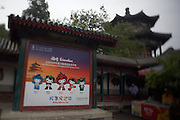 "Imperial Summer Palace (Yihe Yuan). Advertising billboards for the Beijing 2008 Olympics. Olympic mascots (""Friendlies"") from left: Beibei (New Year), Jingjing, the panda, fiery Huanhuan, Yingying the Tibetan antelope and Nini the swallow."