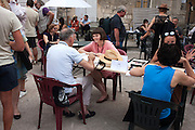 Portfolio reading in Arles during the Opening Week of Les Rencontres de la Photographie in Arles, July 8, 2016.