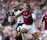 Photo: Chris Ratcliffe.<br /> West Ham United v Tottenham Hotspur. The Barclays Premiership. 07/05/2006.<br /> Anton Ferdinand of West Ham tussles with Jermaine Defoe of Spurs.