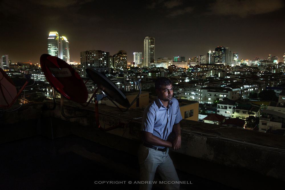 Sri Lankan refugee, Paramanantham Dhushyanthan, 31, from Mannar District, pictured in Bangkok, Thailand<br /> <br /> &quot;I was a member of a political party called EPRLF (Eelam People Revolutionary Liberation Front). I joined them to get work and I became a bus conductor, this is a government job. In the election campaign we had some problems from the government parties, they did not want us to run in the election so they always beat us and warned us not to enter the election. When I was there every day when you go to sleep you don't know if you will wake in the morning, because in my area many people were taken during the night by the military and you will not see them again. They arrive in unmarked vehicles, in Sri Lanka we call it the 'white van'. <br /> <br /> I would not stay in my home because I thought something could happen to me, I stayed in a friend's, or at my sister's. So one day I was kidnapped, it was July 10th, 2008, at 7pm. During that time there were many people kidnapped, we would see many people dead in the mornings by the roadside; the government and their parties would shoot them. That evening six people came in a vehicle, they pointed a gun at my chest and told me to get in the vehicle. They bound my hands, I recognised them, one was from Criminal Investigation Department of Sri Lanka. They took me to an open area and took me out from the vehicle and everyone started to beat me with guns, I was kneeing in front of them and one man loaded a gun and pointed it at my head and was ready to kill me. Then one man said, &quot;don't do it now let's do it later, because when we caught him there was a doctor watching us&quot;. They beat me again and left me. I went to my house and told my mother, the next day my mother took me to Columbo. <br /> <br /> I arranged some money, my sister pawned some things, and I came to Bangkok. A man told me that Bangkok is the only place that the refugees can stay, that you can register with the UNHCR and they will look after you. After I came here people visited my ho