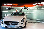 AMG SLS 6.3 Coupe gullwing motor car on display at AMG Mercedes gallery showroom in Odeonsplatz, Munich, Bavaria, Germany