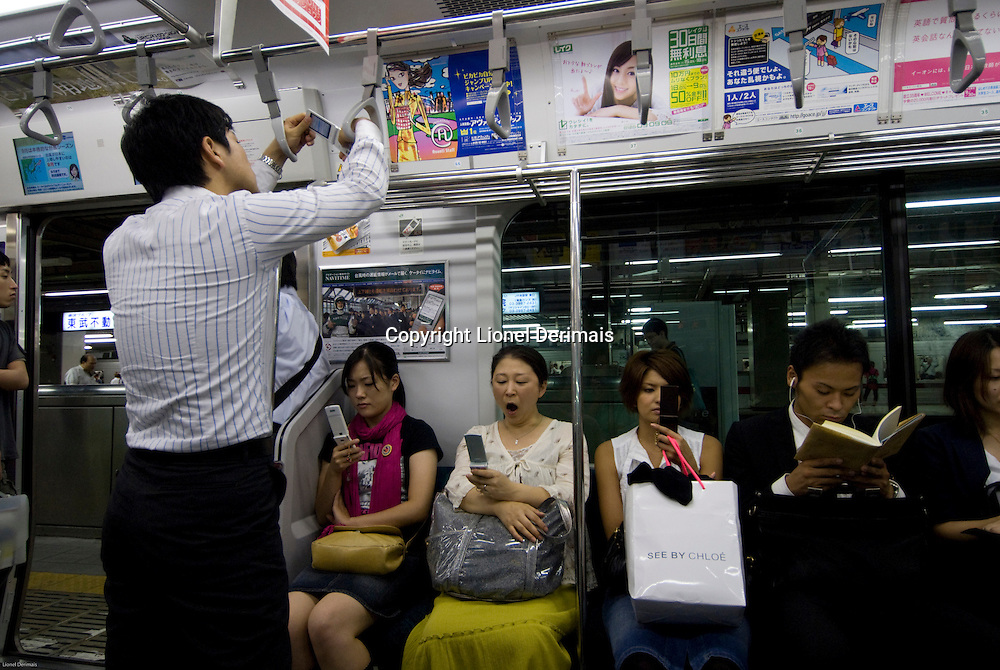 Commuters going home on the Tokyo subway.