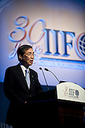 Yoshio Kono, president and CEO of  Norinchukin Bank, speaks during a special session on Japan's reconstruction following last year's earthquake and tsunami during the International Institute of Finance conference in Tokyo, Japan on 11 Oct. 2012. Photographer: Robert Gilhooly