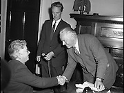 Minister for Posts and Telegraphs, Mr Ormond, making a presentation to the Mistress of Pearse St. Post Office - Miss Eileen O'Grady - at the Minister's Office. 07/07/1958.