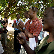 "Rick Copeland dances with ""Nannies"" during the Kenya Learning Tours visit  to Strenthening the House of Nanny project. This project supports 3,191 orphans and 1,027 orphans. The nannies are all over 45 years old and live with a minimum of two orphans whose parents died of HIV. The project helps the elderly nannies finance small income generating programs."