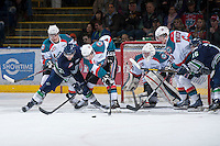 KELOWNA, CANADA - JANUARY 24: Colton Heffley #25, Madison Bowey #4 and Mitchell Wheaton #6 of the Kelowna Rockets check Seth Swenson #21 and Andrew Johnson #16 of the Seattle Thunderbirds in front of Jordon Cooke #30 of the Kelowna Rockets at the Kelowna Rockets on January 24, 2013 at Prospera Place in Kelowna, British Columbia, Canada (Photo by Marissa Baecker/Shoot the Breeze) *** Local Caption ***
