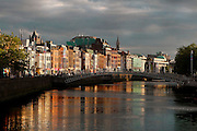 General view of the Ha'penny Bridge, or Liffey Bridge,   (Droichead na Leathphingine, or Droichead na Life), 1816, Dublin, Ireland, in the evening. This single span structure was the first cast-iron bridge in Ireland. Officially named the Liffey Bridge it is usually called the Ha'penny,  from its original halfpenny toll or crossing charge. Picture by Manuel Cohen