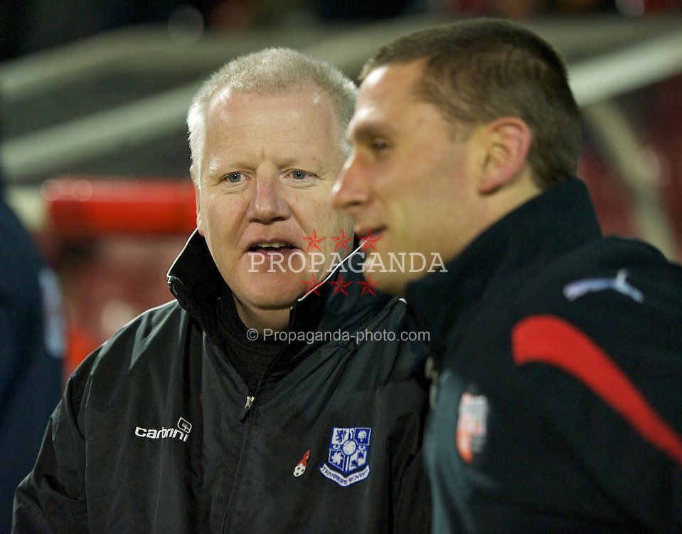 LONDON, ENGLAND - Tuesday, February 22, 2011: Tranmere Rovers' manager Les Parry and Brentford's Andy Scott during the Football League One match at Griffin Park. (Photo by David Rawcliffe/Propaganda)