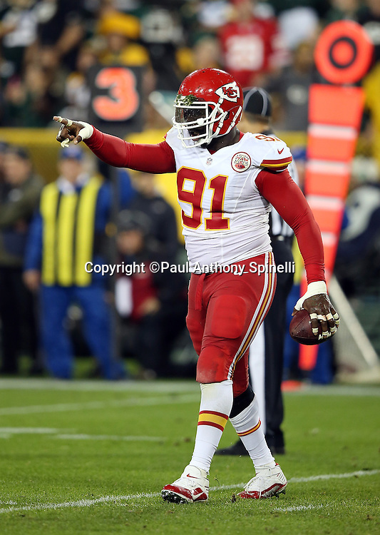 Kansas City Chiefs outside linebacker Tamba Hali (91) points as he celebrates after recovering a second quarter fumble on a quarterback sack (a penalty negated the turnover) during the 2015 NFL week 3 regular season football game against the Green Bay Packers on Monday, Sept. 28, 2015 in Green Bay, Wis. The Packers won the game 38-28. (©Paul Anthony Spinelli)