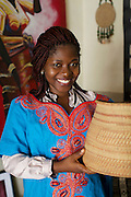 Peace, Youth for Technology, tries on a dress at Maureens shop.<br /> <br /> Maureen Okon runs a craft shop called 'Afrocentric Afrique'.<br /> <br /> Maureen was so inspired by what she learnt, and the other women, at the Youth for Technology business training that she never went back to her consultancy job, she resigned there and then. <br /> <br /> She found the business planning and SWOT analaysis advice the most useful and she uses the business support text messages for ongoing support and motivation.