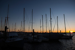 Boats docked at Newport Harbor at sunset, Newport, Rhode Island, United States of America