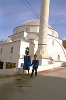 Children returning from school in front of mosque in small rural village in South Western Turkey...