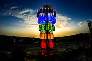 coloured bottles at sunset