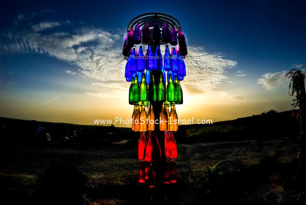 coloured bottles at sunset