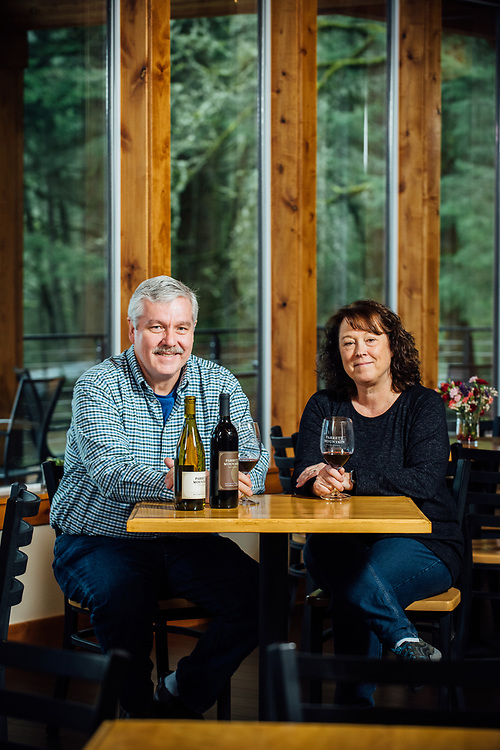 Dennis and Marlene Grant owners and winemaker for Parrot Mountain Cellars in a rare moment sitting down together in their tasting room.