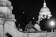 Blenda, a 20-year-old homeless woman, finds a spot to sleep on top of the patriotic fountain featuring Christopher Columbus outside of Union Station in Washington, D.C., September 28, 2017. (photo by Dana Rene Bowler)