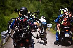 Beth Duryea carries Niewiadoma's spare bike on Monte Zoncolan at Giro Rosa 2018 - Stage 9, a 104.7 km road race from Tricesimo to Monte Zoncolan, Italy on July 14, 2018. Photo by Sean Robinson/velofocus.com