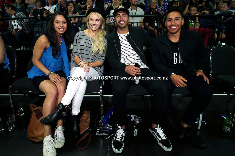 New Zealand actress Kimberley Crossman and Warriors player Shaun Johnson enjoy the action from sideline. 2014/15 ANBL, SkyCity Breakers vs Melbourne United, Vector Arena, Auckland, New Zealand. Friday 21 November 2014. Photo: Anthony Au-Yeung / photosport.co.nz