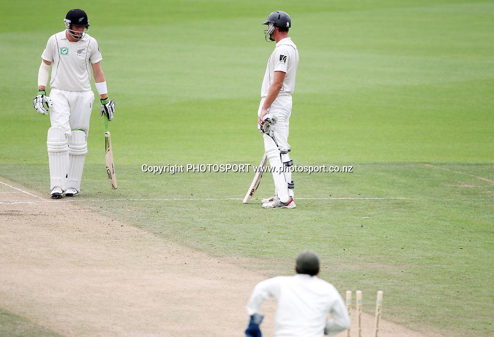 L_R Martin Guptill and Tim McIntosh end up at the same end after Guptill ran out Tim McIntosh.<br />Day 4. Test match cricket. One off test.<br />New Zealand Black Caps versus Bangladesh.<br />Seddon Park, Hamilton, New Zealand.<br />Thursday 18 February 2010.<br />Photo: Andrew Cornaga/PHOTOSPORT