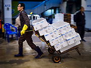 09 OCTOBER 2018 - SEOUL, SOUTH KOREA: A porter hauls a load of fish to an auction in the Noryangjin Fish Market. The auctions start about 01.00 AM and last until 05.00 AM. Noryangjin Fish Market is the largest fish market in Seoul and has been in operation since 1927. It opened in the current location in 1971 and was renovated in 2015. The market serves both retail and wholesale customers and has become a tourist attraction in recent years.           PHOTO BY JACK KURTZ