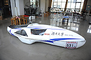 CHANGSHA, CHINA - MAY 27: (CHINA OUT) <br /> <br /> Energy-saving Electric Vehicle In Hunan University<br /> <br /> an energy-saving electric vehicle designed by students of Xiaoxiang Eagle automobile racing team at Hunan University on May 27, 2013 in Changsha, Hunan Province of China. The vehicle was made in 2012. Students designed a new energy-saving electric vehicle in 2013, which was sent to Malaysia on May 26 to take part in the 2013 Shell Eco-marathon. The new vehicle is 2.85m long, 0.7m tall, 0.8m wide and weighs 50kg. According to designers, the new one can run 250 kilometers with one kilowatt hour, with the highest speed of 40 miles per hour.<br /> ©ChinaFoto/Exclusivepix