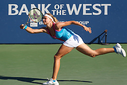 July 28, 2011; Stanford, CA, USA;  Maria Kirilenko (RUS) is unable to return a serve by against Serena Williams (USA), not pictured, during the second round of the Bank of the West Classic women's tennis tournament at the Taube Family Tennis Stadium.  Williams defeated Kirilenko 6-2, 3-6, 6-2.