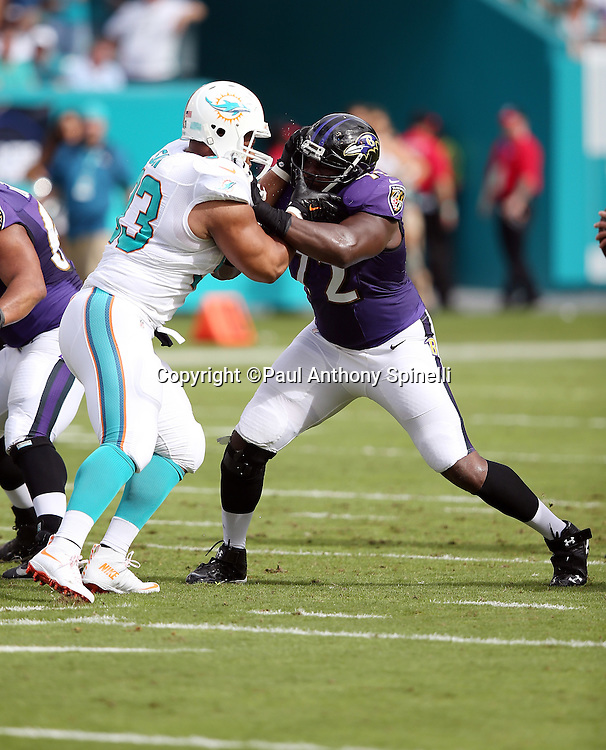 Baltimore Ravens guard Kelechi Osemele (72) blocks Miami Dolphins defensive tackle Ndamukong Suh (93) during the 2015 week 13 regular season NFL football game against the Miami Dolphins on Sunday, Dec. 6, 2015 in Miami Gardens, Fla. The Dolphins won the game 15-13. (©Paul Anthony Spinelli)
