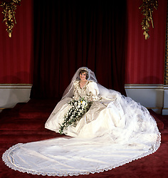 "Embargoed to 0001 Monday August 21 File photo dated 29/07/81 of Diana, Princess of Wales seated in her bridal gown at Buckingham Palace after her marriage to Prince Charles at St. Paul's Cathedral. Diana, Princess of Wales was a woman whose warmth, compassion and empathy for those she met earned her the description the ""people's princess""."