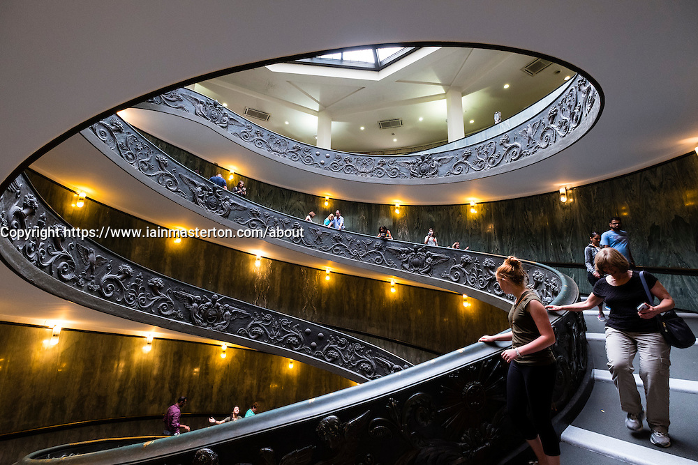 Visitors descend the famous spiral staircase in the  Vatican Museum in Rome, Italy