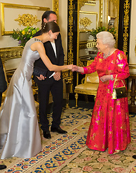 Queen Elizabeth II meets Princess Salwa Aga Khan in the White Drawing Room at Windsor Castle, during a reception before a private dinner to mark the diamond jubilee of the Aga Khan's leadership as Imam of the Shia Ismaili Muslim Community.