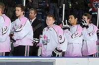 KELOWNA, CANADA, NOVEMBER 5: Brett Bulmer #19 Zach Franko #9, Tyrell Goulbourne #12 and Colton Sissons #15 of the Kelowna Rockets line up on the bench during the national anthem as the Portland Winterhawks visit the Kelowna Rockets  on November 5, 2011 at Prospera Place in Kelowna, British Columbia, Canada (Photo by Marissa Baecker/Shoot the Breeze) *** Local Caption ***