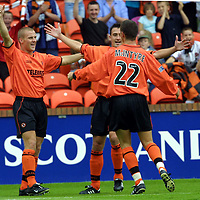 Dundee Utd v Dunfermline.... 18.8.01<br />Derek Lilley and David Hannah  congratulate Jim McIntyre<br /><br />Pic by Graeme Hart<br />Copyright Perthshire Picture Agency<br />Tel: 01738 623350 / 07990 594431