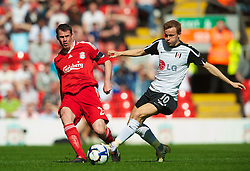LIVERPOOL, ENGLAND - Sunday, April 11, 2010: Liverpool's Jamie Carragher and Fulham's Erik Nevland during the Premiership match at Anfield. (Photo by: David Rawcliffe/Propaganda)