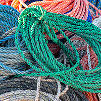 Multi-colored lines waiting their turn on lobster pots. Bernard, Maine.