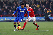 AFC Wimbledon striker Andy Barcham (17) screening the ball during the EFL Sky Bet League 1 match between AFC Wimbledon and Charlton Athletic at the Cherry Red Records Stadium, Kingston, England on 11 February 2017. Photo by Matthew Redman.