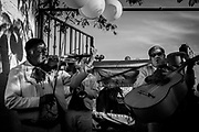A Mariachi group plays during Lupita's birthday party in their frontyard. Mariachis can't be missed at a party in Mexico, where traditions are still held high.