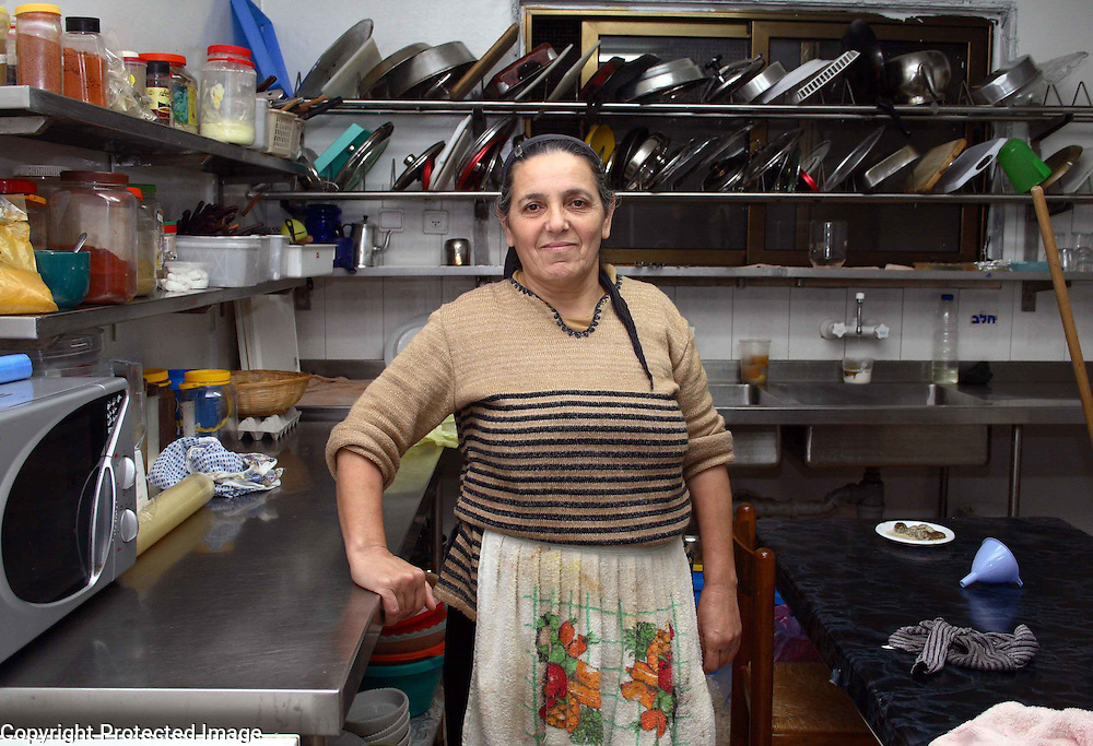 Druse woman with her kitchen, Northern Israel. Portrait/Magazine Photography by Debbie Zimelman, Modiin, Israel