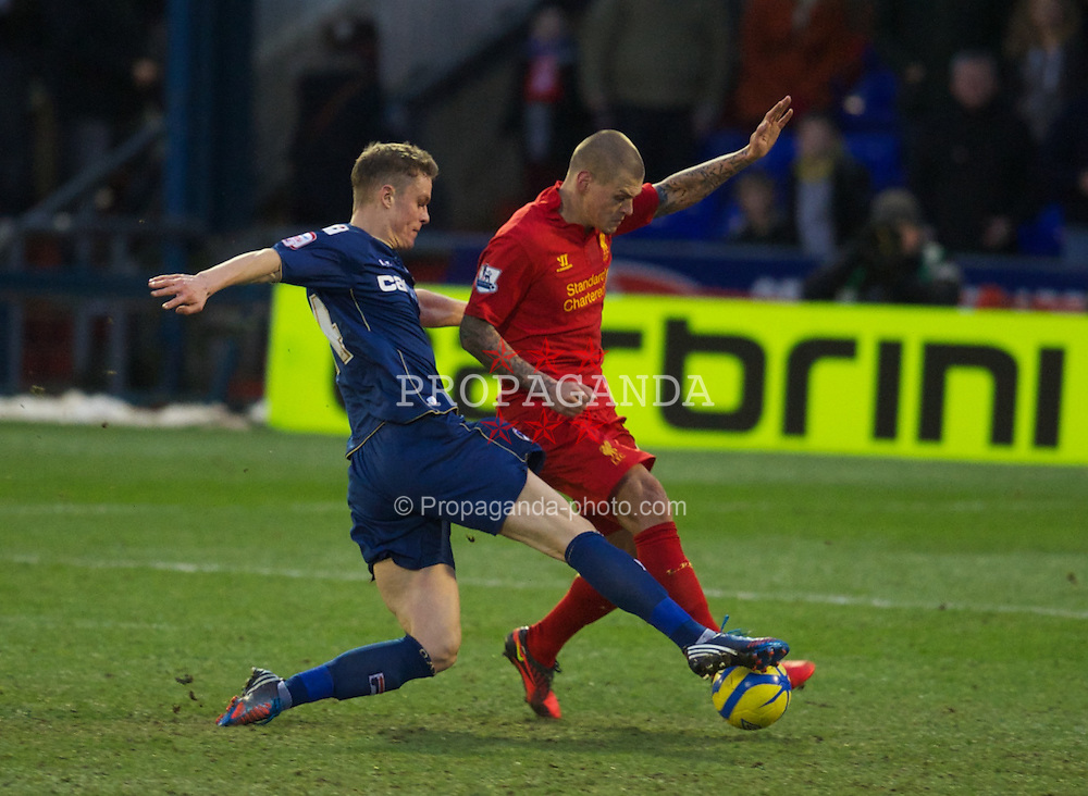 OLDHAM, ENGLAND - Sunday, January 27, 2013: Liverpool's Martin Skrtel in action against Oldham Athletic's Matt Smith during the FA Cup 4th Round match at Boundary Park. (Pic by David Rawcliffe/Propaganda)
