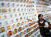 A woman points at a display of hundreds of instant noodles packages at the Momofuku Ando Instant Ramen Museum in Osaka, Japan on 20 October 2008. Instant noodle maker Nissin, which was founded by Ando in 1948, creates several hundred types of instant noodles each year.