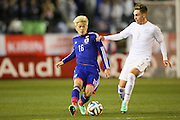 Hotaru Yamaguchi (JPN) challenged by Tyler Boyd (NZL), <br /> MARCH 5, 2014 - Football /Soccer : <br /> Kirin Challenge Cup 2014<br /> between Japan 4-2 New Zealand <br /> at National Stadium, Tokyo, Japan. <br /> (Photo by YUTAKA/AFLO SPORT)
