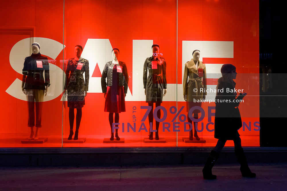 Sale sign and mannequin in London's Regent Street clothing shop window