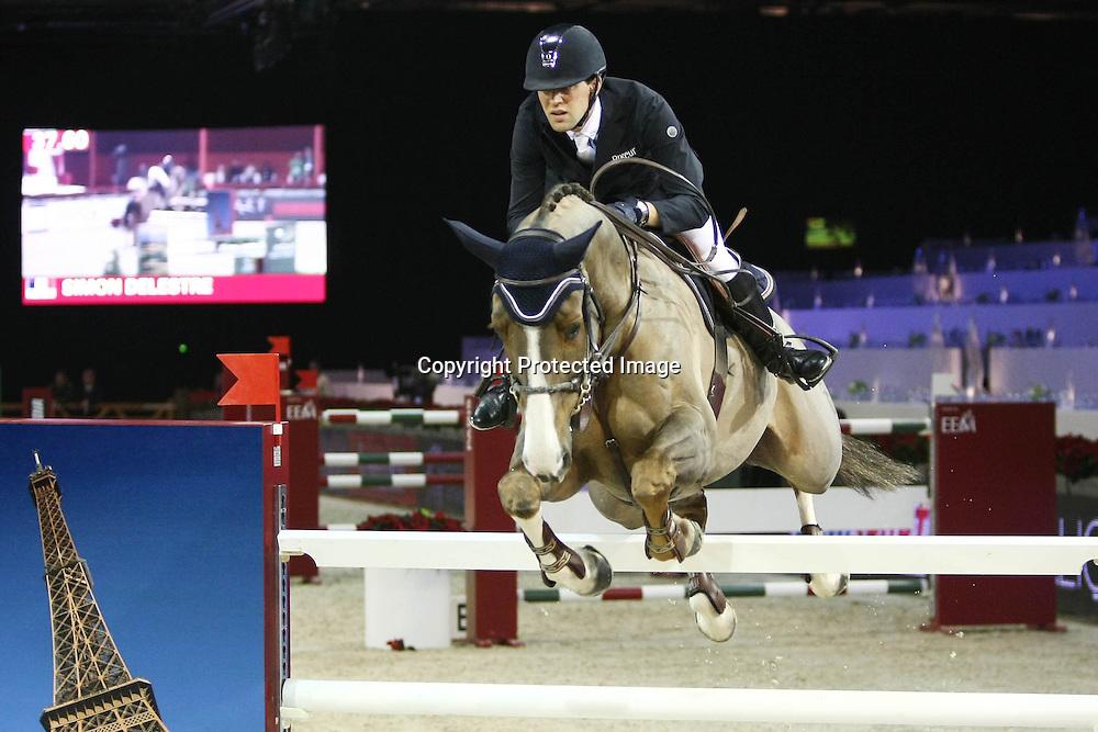 Equitation : Gucci Masters - 03.12.2010 - Prix Le Figaro CSI5 - Simon Delestre (FRA/sur Napoli Du Ry) *** Local Caption *** 00042820