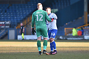 Bury Goalkeeper, Connor Ripley (12) and Bury Midfielder, Zeli Ismail (16)  during the EFL Sky Bet League 1 match between Bury and Gillingham at the JD Stadium, Bury, England on 24 February 2018. Picture by Mark Pollitt.